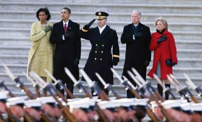President Barack Obama with first lady Michelle Obama, and Vice President Joe Biden with wife Jill Biden, reviewing the troops at the start of the inaugural parade from the Capitol in Washington on Tuesday, Jan 20, 2009. Photograph by Manuel Balce Ceneta / AP