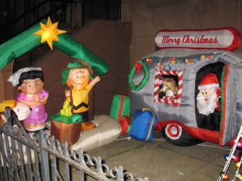 sweet, goofy, inflated figures of Charlie Brown, Lucy and Santa Claus