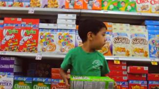 Fed Up documentary; cereal aisle (boy with cereal boxes)