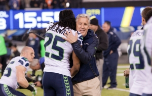 Richard_Sherman_and_Pete_Carroll_in_embrace_Super_Bowl_XLVIII