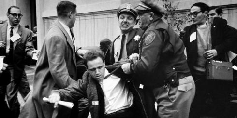 Mario Savio, the leader of Free Speech Movement at Berkeley, being arrested by police, 1964