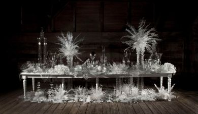 "Beth Lipman, ""Laid (Time-) Table with Cycads,"" 2015. Glass, wood, adhesive and paint. 92 x 192 x 57 inches."