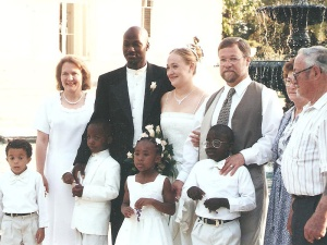 Photo apparently of Rachel Dolezal's wedding. Back row from left to right, according to Lawrence Dolezal: Ruthanne Dolezal, Kevin Moore, Rachel Dolezal, Lawrence Dolezal, and Lawrence Dolezal's parents, Peggy and Herman. Front row: The Dolezals' adopted children — Ezra, Izaiah, Esther and Zach.