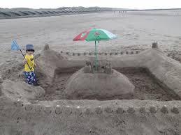 Prestatyn beach, sand castle, boy