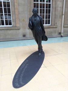Philip Larkin, sculpture, with shadow