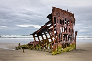 Photographer Peter Iredale. Remains of a sailing vessel that ran ashore on the Oregon coast.