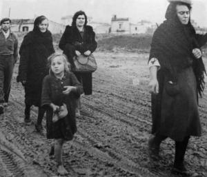 . Italian civilians fleeing an Allied bombing raid, region Abruzzo, December 1943