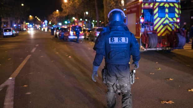 paris attack police officer AP Photo Kamil Zihnioglu