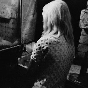 "Nick Hedges, ""Make life worth living,"" photographs for Shelter; at the kitchen sink in a tenement flat, Glasgow, 1970"