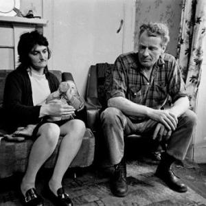 "Nick Hedges, ""Make life worth living,"" photographs for Shelter; couple and child in an Edinburgh tenement flat, 1972"