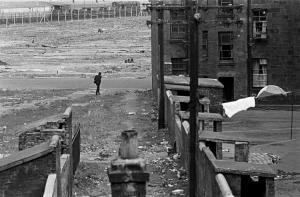 "Nick Hedges, ""Make life worth living,"" photographs for Shelter; tenements and wasteland near Red Road flats, 1971"
