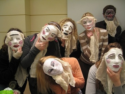 Students in Dramatic Greece class model their theatre masks in Athens - Luther College