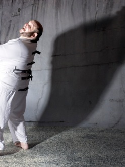 Lawrence Goldhuber in straitjacket, photo by Josh Gosfield