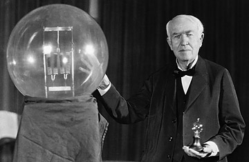 Thomas Edison exhibits a replica of his first successful incandescent lamp - credit, Bettmann-Corbis