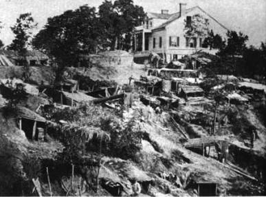 The Shirley House and the encampment of the Fifth Illinois during the siege of Vicksburg, reproduction of a wartime photograph