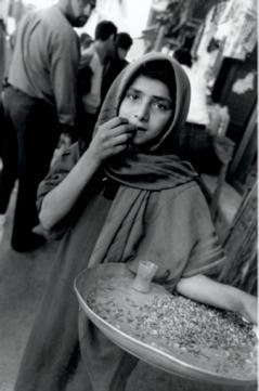 Olive Pierce, Girl selling seeds, Safaafir Market, Baghdad, 1999