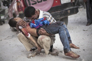 a-syrian-man-holds-lifeless-body-of-his-son-killed-by-syrian-army-aleppo-syria-october-3-2013-photo-by-manu-brabo-ap