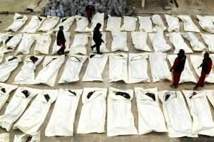Aleppo, Workers document and count dead bodies, Mahmoud Hebbo - Reuters